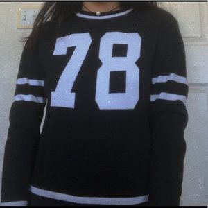 H&M black/white sweater with the numbers 78. 🖤